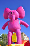 Pink elephant, Magic Kings Parade. HUELVA - JANUARY 5: Colorful funny figures. Big parade of the Biblical Magi Three Kings, who give toys to the children. Is a Stock Photos