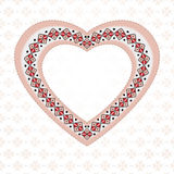 Pink embroidered heart Stock Images