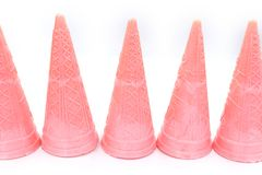 Pink empty ice cream cone isolated on white background. High resolution image gallery stock image