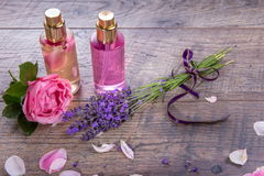 Pink English rose, lavender, organic salt and oil, spa wooden background. Rustic style Stock Photos