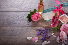 Pink English rose, lavender, organic salt and oil, spa wooden background. Rustic style Stock Image