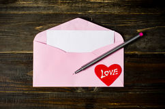 Pink envelop on wooden background Stock Image