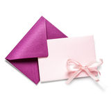 Pink envelope with card. And bow ribbon on white background, clipping path included stock image