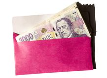 Pink envelope with czech money isolated on the white. Background Royalty Free Stock Photography