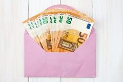 Pink envelope with Euro bills Royalty Free Stock Photos