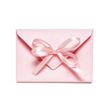 Pink envelope. Light pink envelope with bow ribbon, isolated on white background royalty free stock images