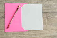 A pink envelope with a piece of paper Royalty Free Stock Photo