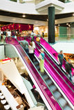 Pink Escalator. A group of person using a pink escalator in a mall Royalty Free Stock Image