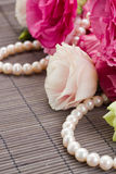 Pink eustoma flowers and pearls Stock Images
