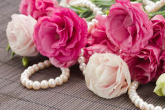 Pink eustoma flowers and pearls border Stock Photo