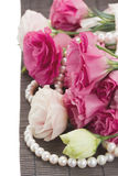 Pink eustomas and pearls border Stock Image