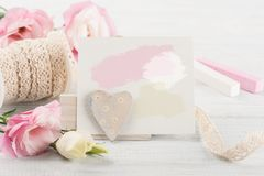 Pink eustomas on a white wooden board, paper Stock Photo