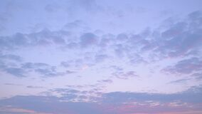 Pink evening clouds, purple skies in calm weather.