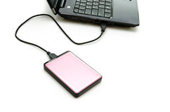 Pink external hard-disk on white Royalty Free Stock Photo