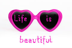 Pink eye glasses - life is beautiful Stock Photos