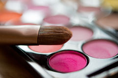 Pink eye shadows with brushes Stock Photography