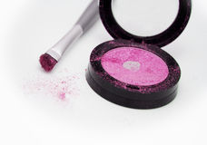 Pink eyeshadow. And brush applicator Royalty Free Stock Image