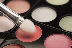 Pink eyeshadow palette with a brush Stock Photos