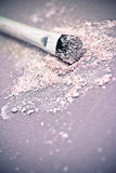 Pink eyeshadow powder and brush Royalty Free Stock Photos