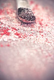 Pink eyeshadow powder and brush Stock Photography