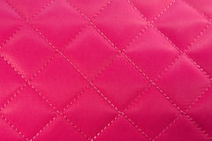 Pink fabric. With a linear stitch Stock Photos