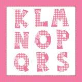 Pink fabric alphabet. Stock Photo