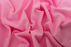 Pink fabric as a background. Crumpled blue fabric texture closeup Stock Photos
