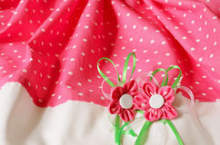 Fabric background with artificial flowers Royalty Free Stock Photo