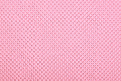 Pink fabric with dots, background. Stock Photos