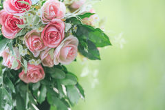 Pink fabric rose flowers bouque vintage on green background with Royalty Free Stock Images