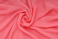 Pink fabric, silk textured backgrounds Stock Images