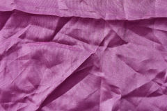 Pink fabric texture with creases. Surface debris, purple, pink fabric with creased crumpled Stock Photo