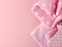 Pink fabrics on pink background Royalty Free Stock Photography