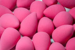 Pink face sponge for cosmetics Stock Image