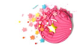 Pink fantasy Eye shadow set isolated on white. A broken pink eye shadow make up palette isolated on a white background. Fantasy star confetti. Top view, flat lay royalty free stock photos
