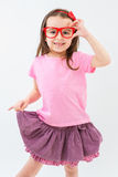 Pink fashionista hand holding red glasses. Schoolgirl shirt skirt form. Empty space on t-shir template for your print. Template for branding Royalty Free Stock Photo