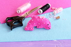 Pink felt dolphin soft toy embellished with beads and button. Fabric sea animal toy Stock Photography