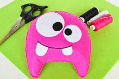 Pink felt monster - handmade toy. Easy crafts for kids. DIY crafts idea. Step. Felt craft projects. DIY ideas made with felt. Cool crafts. Felt craft projects stock photography