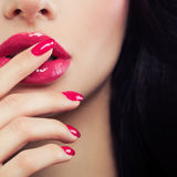 Pink Female Lips and Manicure Hand Close up Stock Photos