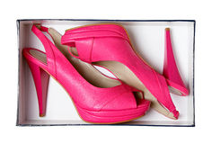 Pink female shoes in box. With clipping path. Stock Photos