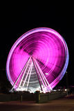 Pink Ferris Wheel. A large city Ferris wheel in pink colors for breast cancer awareness royalty free stock images