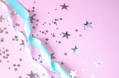 Pink festive background with stars and ribbons stock images