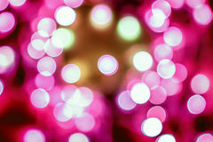 Pink festive Christmas elegant abstract background with bokeh lights Royalty Free Stock Image