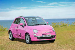 Pink fiat poodle car Royalty Free Stock Image