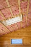 Pink Fiberglass Rood Insulation. Fibreglass insulation installed in the sloping ceiling of a timber house royalty free stock images