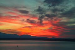 Sailboat Lone at sunset in the Puget Sound. Seattle, Washington stock photos