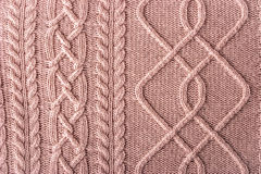 Pink figured sweater background Royalty Free Stock Image