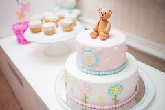 Pink First Year Birthday Cake. With bear and circles royalty free stock photo