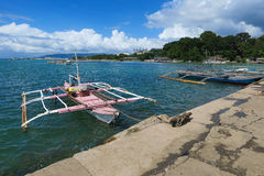 Pink Fishing Boat Docked in Local Village Stock Images