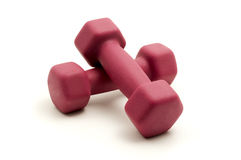 Pink fixed-weight dumbbells Royalty Free Stock Photography